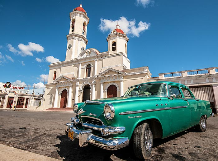 Old car and church in Cienfuegos, Cuba.